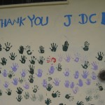 Part of the mural in the village - handprints are from the schoolchildren.
